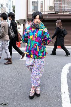 Gero is wearing a bold patterned top from a resale shop with ligher colored patterned pants which she also picked up resale, Trolls tights (or socks), and sparkling Tokyo Bopper platform shoes. Accessories – some of which she bought at toy stores – include a scarf, a monster ring, and a Scooby-Doo backpack with several SpongeBob Squarepants charms attached.