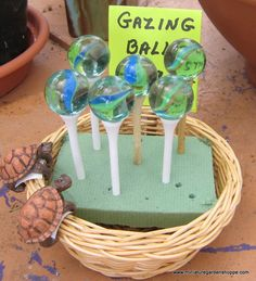 "Miniature Garden Inspiration Gallery - A golf tee topped with a ""cat's eye"" marble becomes a gazing ball on a stand for a miniature fairy garden. Mini Fairy Garden, Fairy Garden Houses, Gnome Garden, Fairy Gardening, Fairies Garden, Indoor Gardening, Organic Gardening, Gardening Quotes, Flowers Garden"