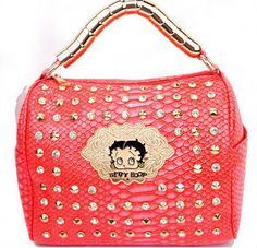 This Official Betty Boop® 'B' Studded Handbag features: - Betty Boop's® name and image on the front accented by spiked metal studs and a rhinestone 'B' lock style closure in silvertone hardware. - Dou