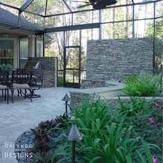 Blurring the lines, one design at a time. By adding the stacked stone seating and lush green plants, we were able to bring the outdoors in.
