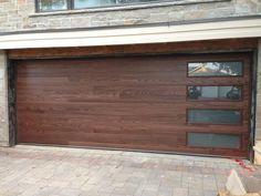 Check out this first class garage door - what an innovative project fa .Check out this first class garage door - what an innovative farmhousegaragedoor projectWood Garage Door Cost Sportactualite Co Modern Wood Garage Doors Modern Garage Doors, Garage Door Styles, Wood Garage Doors, Garage Door Design, Fiberglass Garage Doors, Barn Garage, Brown Garage Door, Garage Door Hardware, Black Window Frames