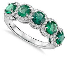 Five stone emerald halo engagement ring. Click to find out everything you really need to know about emerald engagement rings!