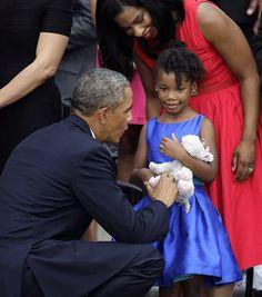 President Obama greets Dr. Martin Luther King, Jr's granddaughter, Yolanda Renee.