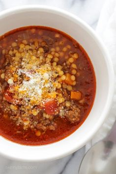 My family DEVOURED this delicious bowl of soup made with ground beef, tomatoes, and tiny pasta. It's warm and comforting, like a great big hug on a cold winter day.     I was snowed in yesterday, which meant soup day. It also gave me an opportunity to make this AMAZING soup that's been on my mind since I tried something similar from a small deli who called it Grandma's Soup. I loved how the bits of meat tasted almost like meatballs, without having to do the extra work.  Tommy and my oldest…