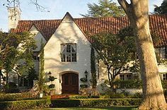exterior is showcased on Houzz, and the paint colors are noted as Sherwan Williams Neutral Ground, the trim as  and Stone Lion.