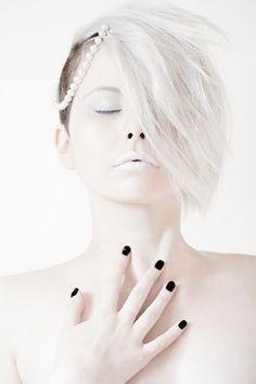 White makeup and black nailpolish. White hair too