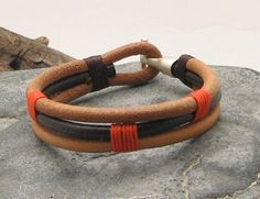 Men's leather bracelet. Multi strand brown and natural leather bracelet with silver plated clasp.