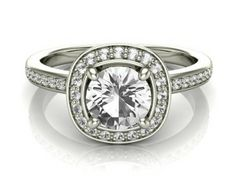 Stunning vintage style diamond ring with a total carat weight of 0.73 carats set in 18k white gold.