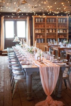 Garden shed decorated with chiffon table runner, lush florals by Kate Farley Design, and white tapers :: A Romantic Spring Wedding at Terrain at Styers :: Heart & Dash :: Svetlana Photography #wedding #peachwedding