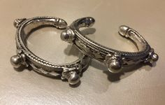 These high silver bracelets are super heavy - 150 grams. The size is very small and therefore, they have most probably belonged to a girl from a rather wealthy family.
