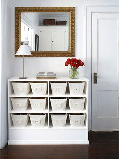 "Original Bookshelf Use          Co-opt small spots of empty wall for attractive storage.          -- Find (or build) a bookcase that fits the wall space.          -- Fill with matching baskets or containers. We used canvas bins and dropped in numbered labels (a coordinating ""key"" tucks into the first basket)."
