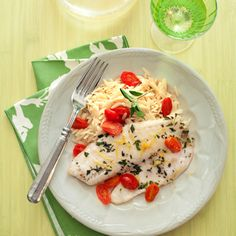 Greek-Style Tilapia, this healthy Mediterranean fish dish boasts fresh oregano leaves, grape tomatoes, and orzo. Sounds pretty perfect.