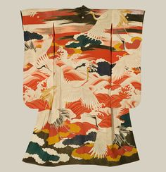 A silk furisode featuring embroidery, yuzen-dyeing and gold foil outlining. Late Meiji (1890-1912), Japan. The Kimono Gallery
