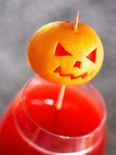 Jack-o-lantern drink garnish (made from a clementine)