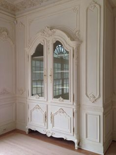Detail of HAND CARVED solid wood china cabinets & authentic Boiserie dining room by Auffrance.  Auffrance.com