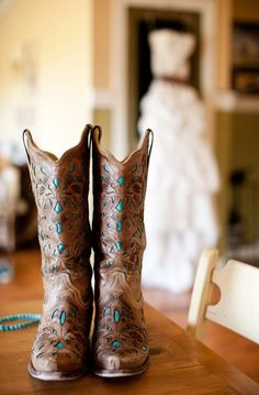Cowboy boots for wedding shoes: http://www.stylemepretty.com/2014/09/17/10-real-weddings-planned-on-a-budget/   Photography: Nyk + Cali Photography - http://www.nykandcali.com/