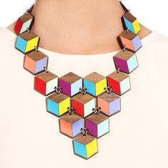 """""""Laser cut walnut wood + Formica = #Geometric perfection! Our new #AW14 jewellery takes on the pattern trend in Tatty Devine style. ✏️"""""""