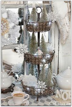 Three tier basket with bottle brush trees for Christmas.