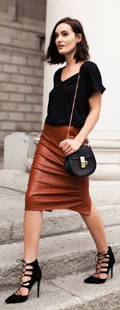 Go easy chic by pairing a slouchy tee with your leather skirt and some killer heels! You'll have everyone staring, you bombshell babe! Where would you sport this look?