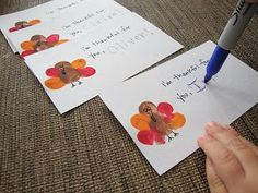 Thumbprint turkeys on cards to share what you're thankful for