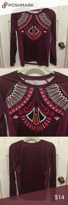 Athleta Shirt Athleta Shirt. Size Small (measures approximately 17 inches armpit to armpit. Purple with pattern colors black/white/pink/orange. Body 87% Polyester/13% Spandex. Mesh on sides 89/% Polyester/11% Spandex. In good preowned condition. Please ask all questions prior to making an offer or purchase. Thanks for stopping by my closet! Athleta Tops Tees - Long Sleeve