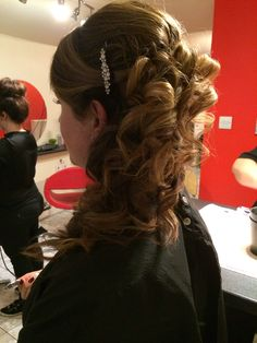 Hair up side flowing curls