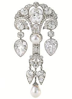 A platinum, natural pearl and diamond corsage ornament, circa 1910