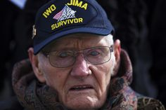 Lloyd Ford, a Marine veteran of World War II, observes a wreath laying ceremony at the Marine Corps War Memorial in Washington. The Ceremony commemorated the anniversary of the battle for Iwo Jima. Military Veterans, Military Personnel, Military Humor, Military Service, Battle Of Iwo Jima, American Veterans, American Soldiers, Us Marines, Real Hero