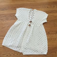 Free People open weave knit top Off white crochet top with a two button closures.  Short sleeves Free People Tops