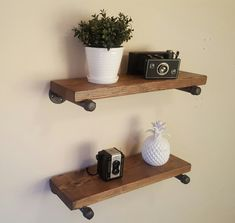 Stylish floating pipe shelves. Made from real 3/4 iron pipe that has been cleaned and painted. Shelves are beautiful stained distressed 2 thick wood. You choose your stain color. Standard length is 36 and standard depth is 10, but I can make them whatever size you want. Very easy to install. All hardware included. 24 and 36 long shelves come with 2 pipe braces each, 48+ long shelves comes with 3 pipe braces each. Looking for something else? Send me a picture and I can build it
