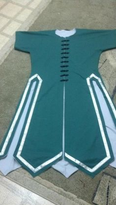 Battle Dress Front with black frogs. Hunter Green with Silver (Grey cause it's not shiny) lining and silver trim. https://www.etsy.com/shop/AureliasRegalia