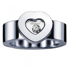 My favorite ring, of all time.  Chopard, floating diamond thick heart. White gold.