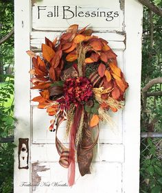 This is a Simple Wreath of Silk Fall Magnolia Leaves. I have Added a Hydrangea Head that is a Mixture of Both Red and Oranges. There is also some Dried Wheat Type Stems, Cornhusks and Berries. I Finished out this Wreath with a Pretty Wired Ribbon in Brown with a Gold Leaf Print, A Wired Fall Plaid, Wired Brown Ribbon and Some Brick Red Sheer Wired Ribbon. The Simplicity of this one is so Pretty :) This Wreath Measures 22 in Length and is 22 Across Leaf Tip to Leaf Tip...I did NOT include the…