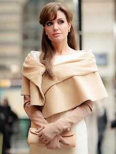"...Angelina Jolie in ""The Tourist""... one dress more impressive than the other..."