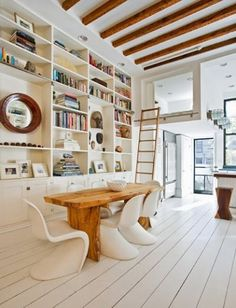 Beams. Built-in shelves. Ladder to a secret nook. Chairs.