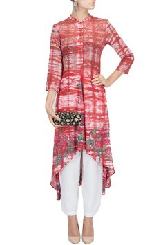 Red tie and dye asymmetrical kurta with trousers BY KRISHNA MEHTA.