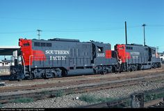 """SP GP9s 3005 and 3007 in Commute train service at San Francisco, CA on August 28, 1975. (In the Bay Area, the trains operating between San Francisco and San Jose were known as """"Commutes"""" and not """"commuter"""".) These GP9 were built by EMD in April 1955 with dual control stands for use on these trains (and as a result, red """"wings"""" on both ends as well, since either end could be on the point of a train). SP 3005 was originally SP 5623, and SP 3007 is the former SP 5625. SP 3005 has since been…"""