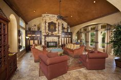 arched ceiling arched doorways stone wall marble floor ceiling fan customized cabinet red sofa of Lively Tuscan Interior Design: The Idea Serving You Best Homey Feeling