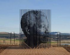 Viewed from one angle you see Mandela's face: The Freedom Fighter – Nelson Mandela Sculpture made of Prison Bars