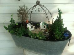 LOVE the trellis structure in this fairy garden.