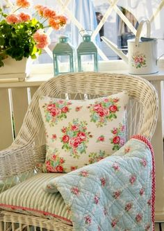 Cottage chair, wicker, floral quilt and pillow, sweet geraniums in the window sill...perfection for afternoon tea and reading!