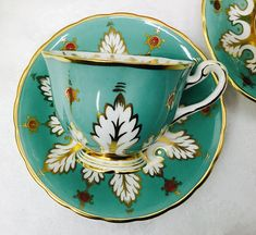 Royal Chelsea teacup and saucer. No chips, crazing or gold loss. Excellent condition. Both pieces ring nicely. If you are looking for spectacular this is the set you want. I have two sets available to purchase and I can combine shipping if you would like to purchase both. The colours