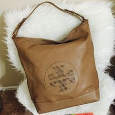 """Tory Burch Hobo Handbag ✅PRICE IS FIRM✅This is a gift from my husband, worn only about 3-4X since the bag is too tall for my 5ft height, I can't wear them as often as I love to. Perfect for travels, beige color, gold hardwares with Tory Burch signature. It has 2 open pockets and 1 security pocket inside. Dustbag included.  Measures 16""""Lx15.5""""Hx6""""Depth; Strap Drop 4"""" to the maximum hole adjustment.   Has very tiny mark at the right bottom corner. No smell, tear, stains or scuff at the bottom…"""