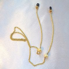 Eye Glass Holders in Gold with Golden Pearls by BathshebasJewels Eyeglass Holder, Gold Necklace, Pendant Necklace, Gold Eyes, Glass Holders, The Girl Who, Fashion Forward, Buy And Sell, Jewels