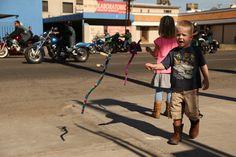 Revolucion parade in Mexicali, Baja. The kids got lizards.