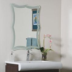The Coquette Frame-less mirror is a masterpiece of classic contemporary work brought to your bathroom, living room or master bedroom suite. The Coquette mirror is crafted of thick, strong 3/16 glass and metal.