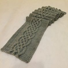 This scarf has a bold & broad celtic knot statement. The Celtic Knot Cable Scarf is wide and well suited for cold climate for anyone, but would especially look stunning on a man. Make this loom knit scarf for your loved one!