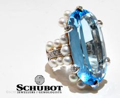 Blue topaz, pearl and diamond ring.