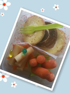 "No Lunch for Friday "" Pizza Day~"" Snack : Leftover roll cakes(coconut and chocolate flavors), fish sausages (you can buy in an Asian store) and carrots for snack!"