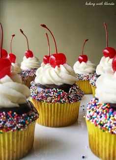 Banana Split Cupcakes - I would do a variation with banana cake, cherry pieces, chocolate filling, whipped cream topping, cherry and sprinkles
